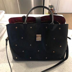 Studded black faux leather handbag